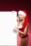 Christmas woman woman holding signboard. Stock Photography