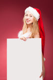 Christmas woman woman holding signboard. Stock Images