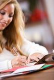 Christmas: Woman Writing Christmas Cards Stock Photography