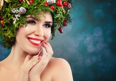 Christmas Woman with Xmas Decorations. stock photo