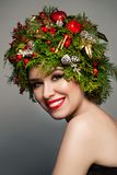 Christmas Woman with Xmas Decorations Royalty Free Stock Photography