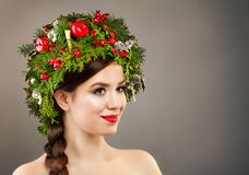 Christmas Woman with Xmas Tree Wreath, Makeup Royalty Free Stock Photography