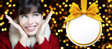 Christmas women with ball in golden lights background Stock Photo