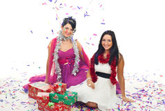 Christmas women at party with confetti and gifts royalty free stock image