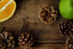 Christmas wood background with fruits and spices Royalty Free Stock Images