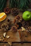 Christmas wood background with fruits and spices Stock Images