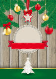 Christmas Wood Green Twigs. Christmas retro design flyer with baubles and twigs Royalty Free Stock Images