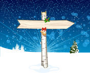 Christmas wooden arrow sign background Stock Photography