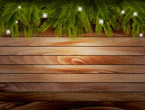 Christmas wooden background with branches and baubles. Vector Stock Image