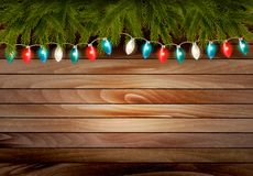 Christmas wooden background with branches and a garland. Royalty Free Stock Images