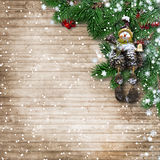 Christmas wooden background with branches,toys from cones, snow Stock Images