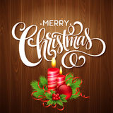 Christmas wooden background with burning candles Stock Images