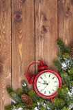 Christmas wooden background with clock, snow fir tree Stock Photo