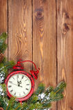 Christmas wooden background with clock, snow fir tree Royalty Free Stock Photos