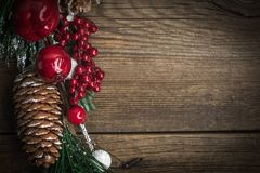 Christmas wooden background with cone and snow tree. Copy space Royalty Free Stock Images