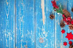Christmas wooden background with cone and snow tree. Copy space Stock Images