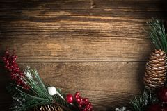 Christmas wooden background with cone and snow tree. Copy space Royalty Free Stock Photo