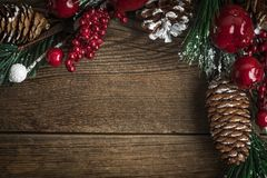 Christmas wooden background with cone and snow tree. Copy space Stock Photos