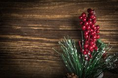 Christmas wooden background with cone and snow tree. Copy space Stock Photography