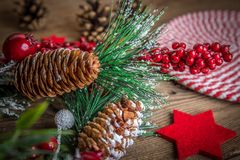 Christmas wooden background with cone and snow tree. Copy space Stock Photo