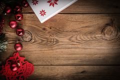 Christmas wooden background with cone and snow tree. Copy space Royalty Free Stock Image
