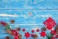 Christmas wooden background with cone and snow tree. Copy space Royalty Free Stock Photos
