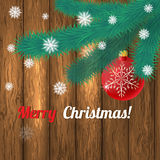 Christmas wooden background with fir branches and balls Royalty Free Stock Image