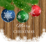 Christmas wooden background with fir branches and balls Royalty Free Stock Photography