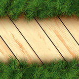 Christmas wooden background. Christmas background with fir branches and wooden boards. Vector illustration Royalty Free Stock Image