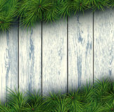 Christmas wooden background. Christmas background with fir branches and wooden boards. Vector illustration Stock Photo