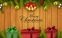 Christmas wooden background with fir branches and gift boxes Stock Photo