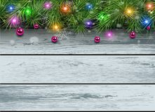 Christmas wooden background. With fir branches and lights. Vector illustration Stock Image