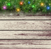 Christmas wooden background. With fir branches and lights. Vector illustration Royalty Free Stock Photography