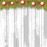 Christmas wooden background with fir branches pine cone and red Royalty Free Stock Photo