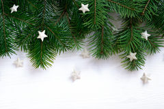 Christmas wooden background with fir branches and stars. Christmas wooden white background with white stars Stock Photo