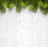 Christmas wooden background with fir branches Stock Photos