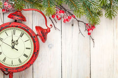 Christmas wooden background with fir tree and antique alarm cloc Stock Photo