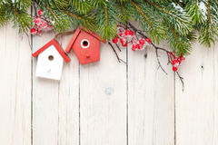 Christmas wooden background with fir tree and birdhouse decor Royalty Free Stock Image