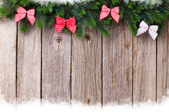 Christmas wooden background with fir tree and bow Royalty Free Stock Photo