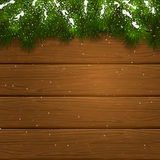 Christmas wooden background with fir tree branches and snow. Christmas theme, decorative spruce branches and snow on a wooden background, illustration Royalty Free Stock Photo
