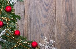 Christmas wooden background with fir tree. Christmas decoration frame on wooden background. View with copy space. Space royalty free stock photos