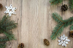 Christmas wooden background with fir tree and handmade snowflakes. Flat lay, top view Royalty Free Stock Images