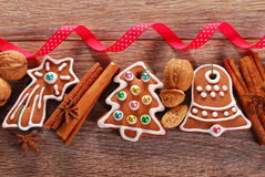 Christmas wooden background with gingerbread cookies Royalty Free Stock Photography
