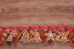 Christmas wooden background with gingerbread cookies Stock Photo