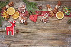 Christmas wooden background with gingerbread cookies and deer. Toned, copy space Stock Photography