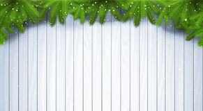 Christmas Wooden Background With Green Fir Branches And Snowflakes Stock Image