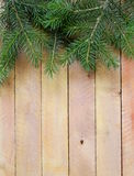 Christmas wooden background is green fir tree Royalty Free Stock Photography