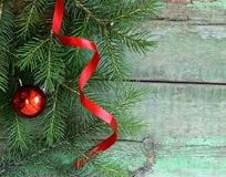 Christmas wooden background is green fir tree Stock Image