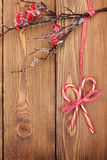 Christmas wooden background with holly berry branch and candy ca Stock Images