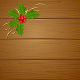 Christmas wooden background with holly berry Royalty Free Stock Photography